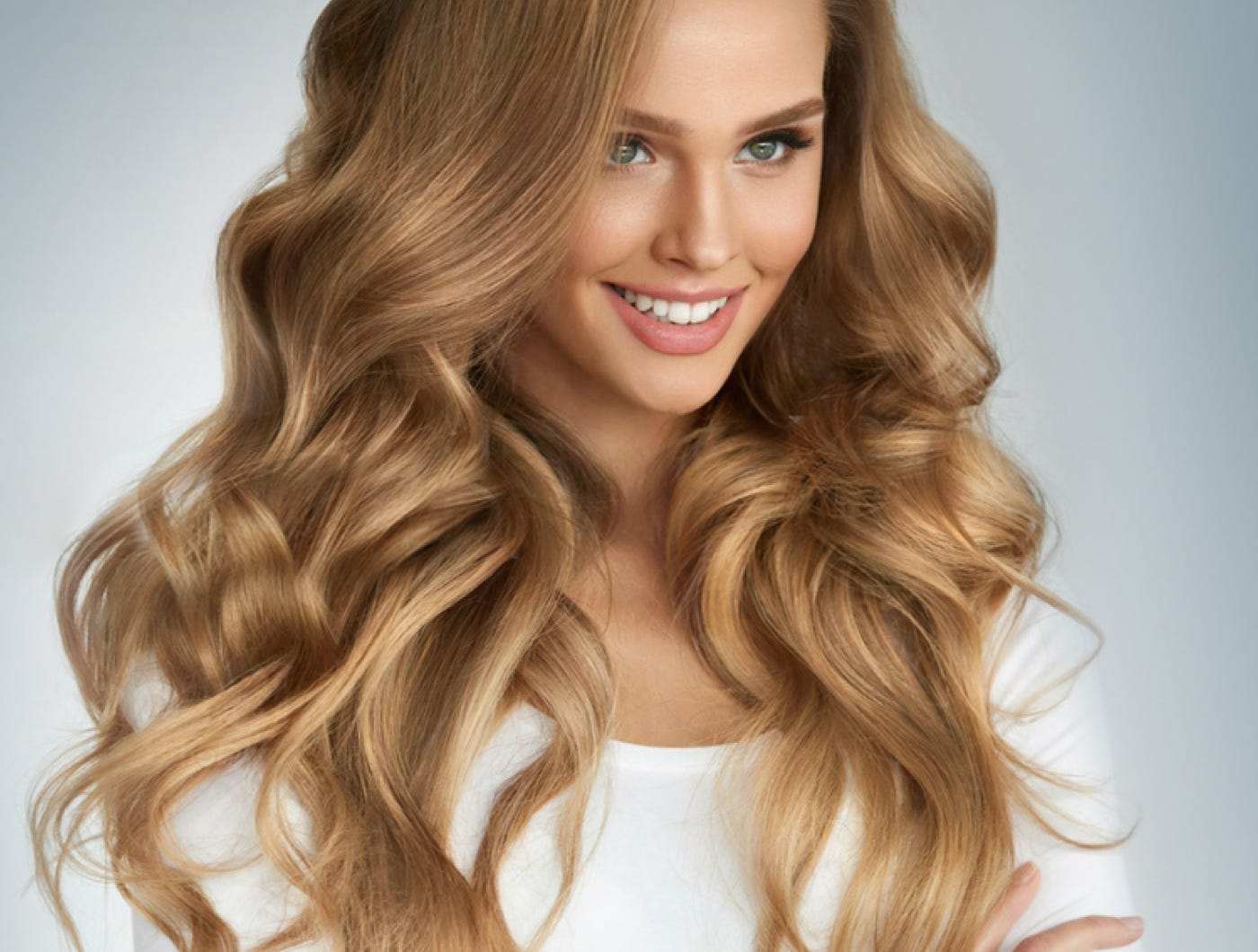 Woman smiling with great hair.